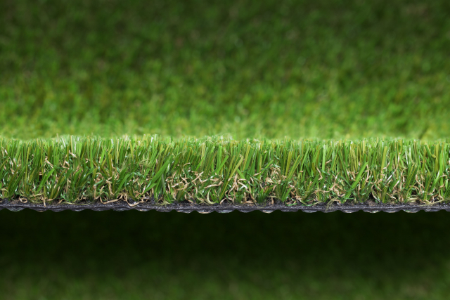 Why are there brown curls in fake grass?